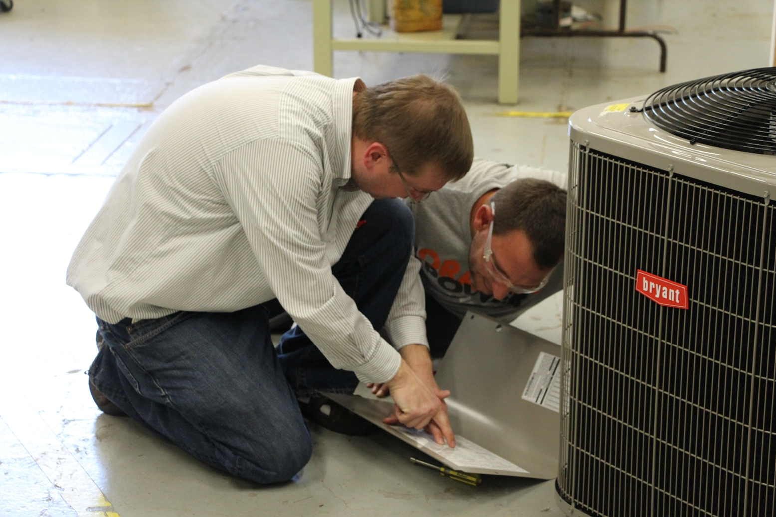 HVAC students analyze an AC unit in the shop