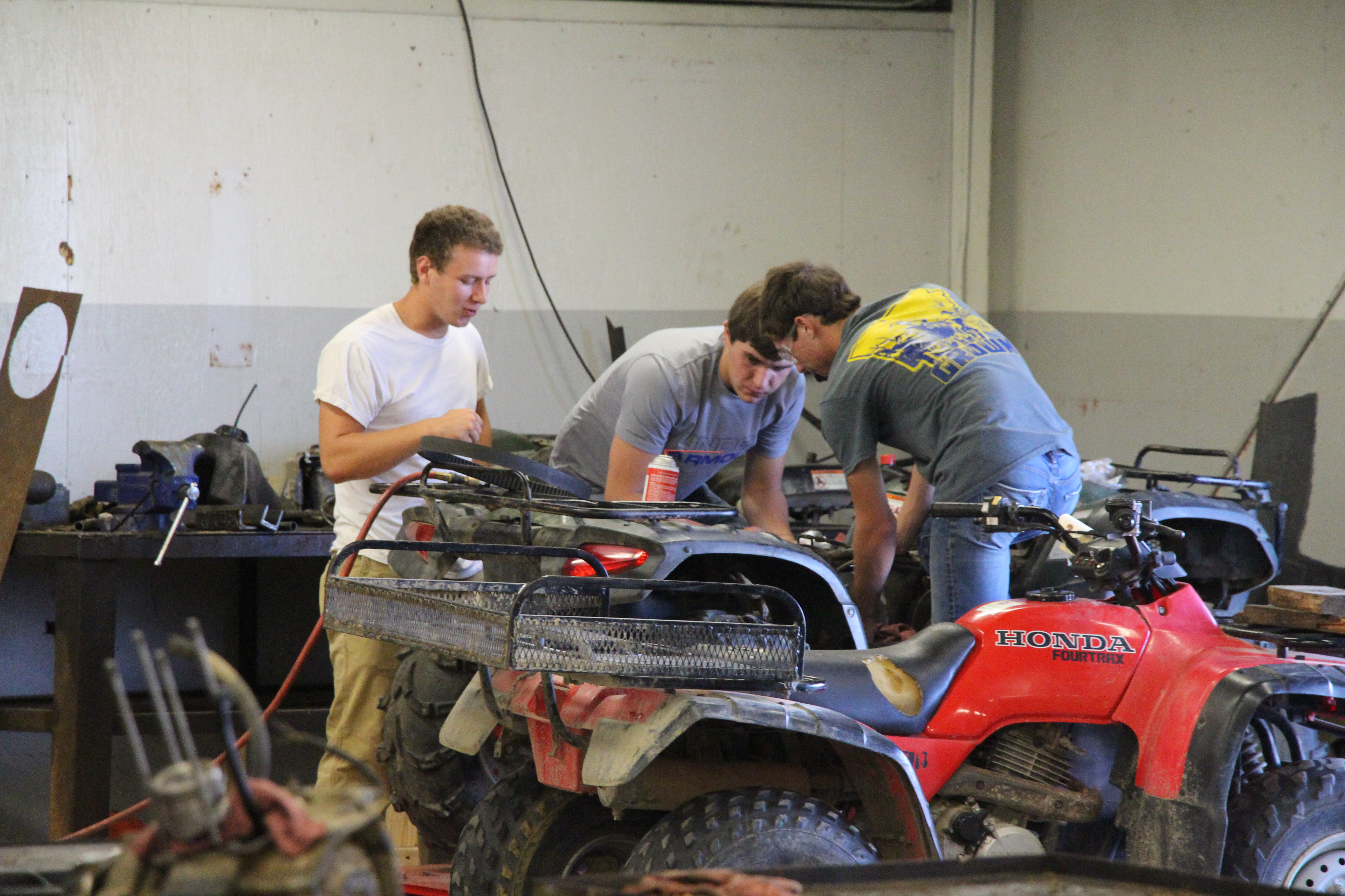 Outdoor Power Students work on 4-wheelers in the shop