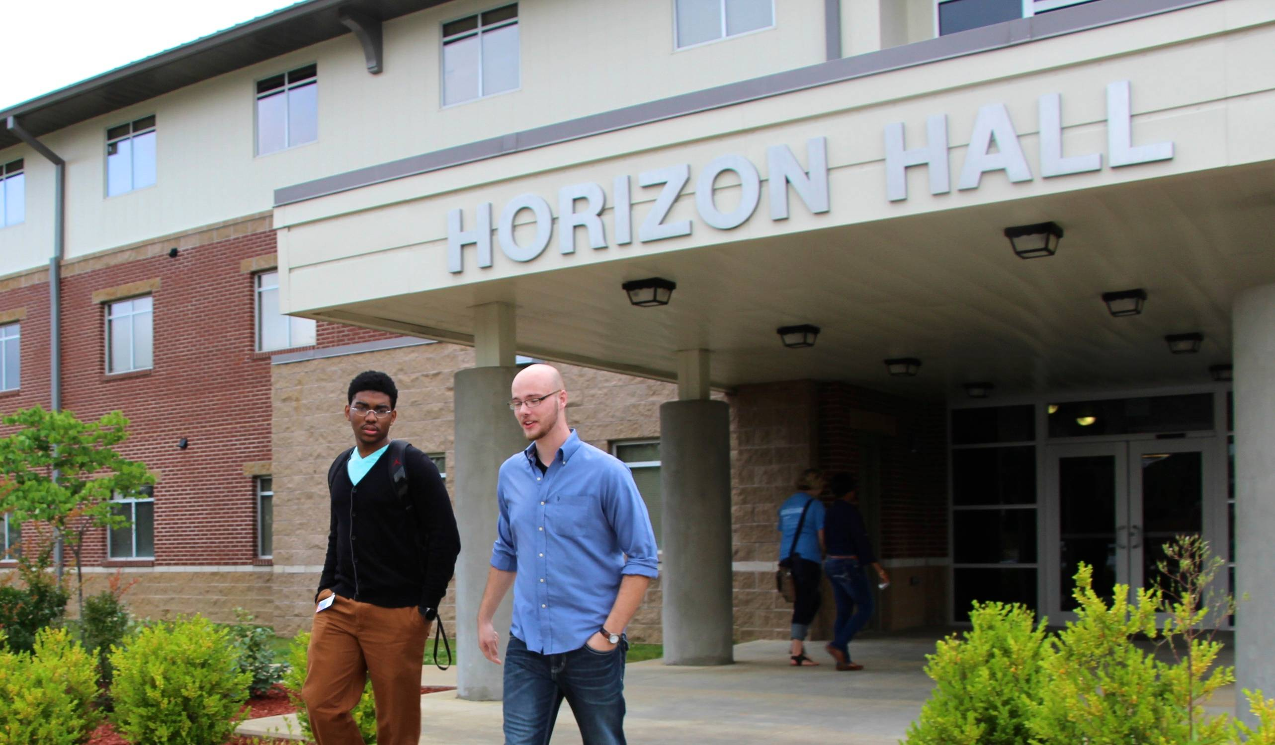 students walking by Horizon Hall